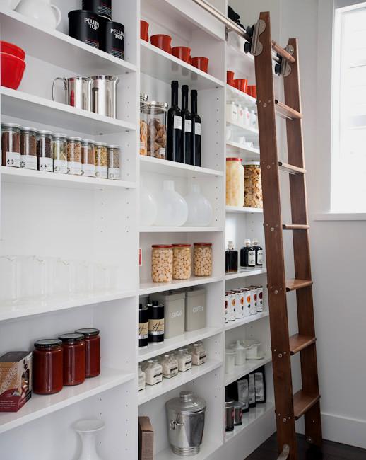 pantry ladder white shelves white wall wooden ladder glass window dark flooring ladder rail glass jairs colorful storages cups