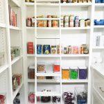 Pantry Ladder White Walls White Shelves Glass Storage Jars Cans Black Flooring White Wooden Ladder White Drawers White Cups Glass Baskets