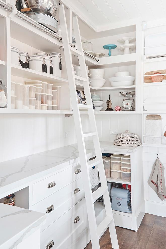 pantry ladder white wooden ladder white wooden shelves storages wooden floor white marble countertop white backsplash white rack drawers