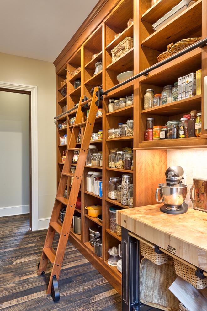 pantry ladder wooden ladder black iron ladder rod railing wheels wooden floor wooden shelves glass jars wooden table coffee maker