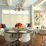 Round Wood Table Top Colorful Chandelier White Eames Chairs Iron Table Base Wooden Floor Window Bench Artwork Windows Shade Colorful Pillows