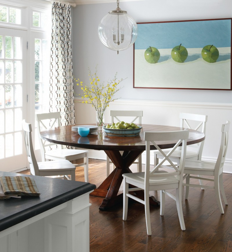 round wood table top glass pendant lamp pedestal table wooden floor white wooden dining chairs grey countertop artwork white french doors white curtains