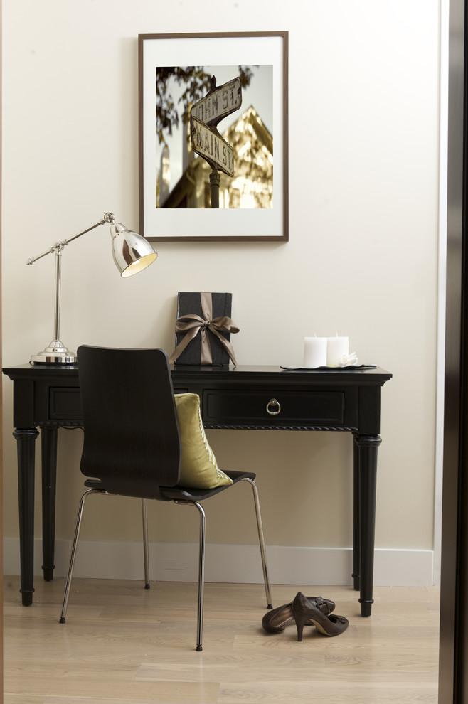 small writing desk with drawers black wooden desk modern black chair chrome table lamp light wooden flooring beige wall artwork