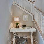 Small Writing Desk With Drawers White Desk Grey Wooden Floring Grey Walls Gold Frame Light Fixture White Wooden Railings Staircase