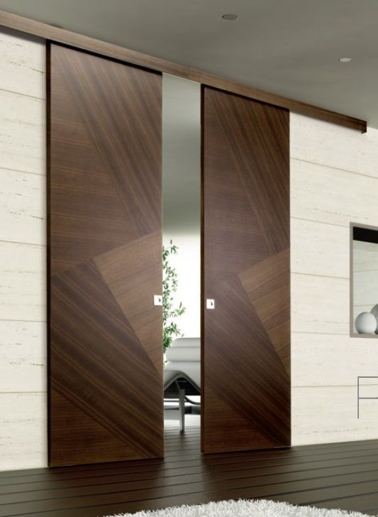 tall glossy wooden sliding door with zigzag patter