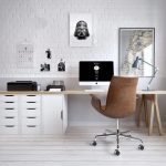 A Stury With White Open Brick Wall, White Wooden Floor, Light Brown Table With White Cabinet, Brown Chair, Pictures
