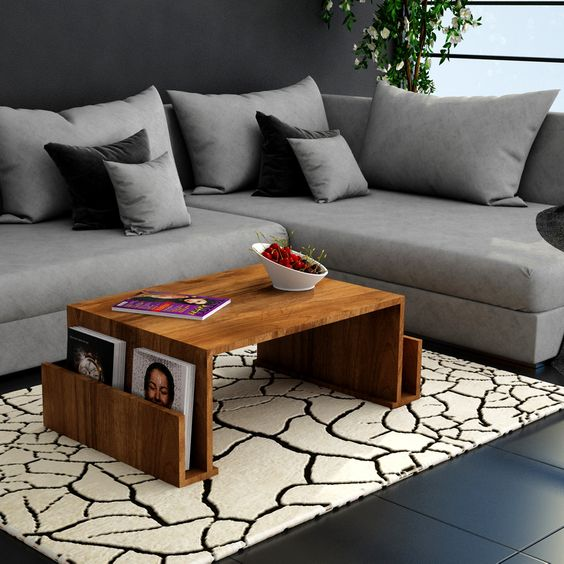 a wooden coffee table with L shaped wing on both end for magazines and bookshelvs