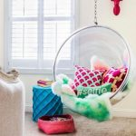 Acrylic Round Swing With Pillows, Pink Rug, White Wall, Blue Ottoman