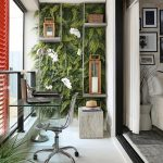 Balcony White Floor, Glass Windows, Red Shade, Floating Shelves, Plants On The Wall, Acrylic Table And Chair