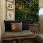 Balcony With Brown Floor, Wooden Bench With Grey Cushions, Pillows, Pictures, Plants On The Wall, Windows