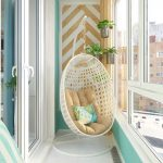 Balcony With White Floor, Green Wall, White Swinging Chair, Accent Wall