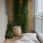 Balcony With Wooden Floor, Windows, White Wall, Bamboo, Plants, Ottoman