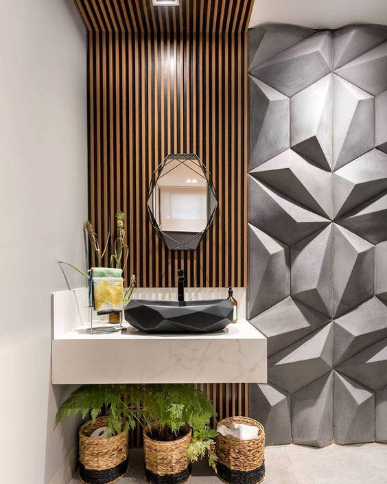 bathroom beige floor, beige wall, wooden accent on wall ceiling, white marble vanity, black geometric sink, grey geometric textured wall, geometric mirror