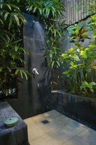 bathroom beige floor, grey wall, grey pot, plants, showe, grey stones vanity