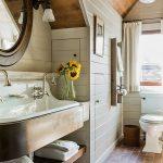 Bathroom, Briwn Floor Tiles, Rug, Large White Sink, Copper Shelves, Round Mirror, Wood Planks Wal, White Toilet