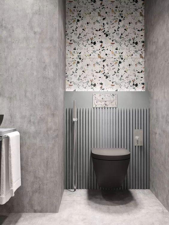 bathroom, grey floor, grey wall, terrazzo accent wall, grey lattice accent wall