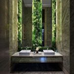Bathroom Grey Marble Floor, Grey Marble Wall, Tall Thin Mirror, Marble Vanity With White Sink, Plants On The Wall