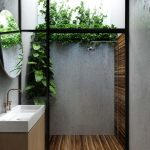 Bathroom Herringbone Tiles, White Sink, Wooden Cabinet, Round Mirror, Outdoor Shower Are, Wooden Floor, Grey Wall, Planst Along The Wall