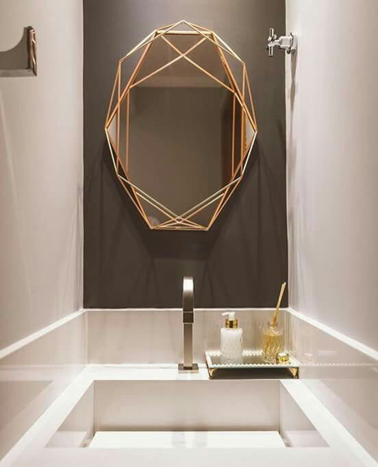 bathroom mirror with golden lines frame from the outlines to the mirror itself