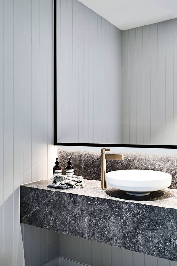bathroom vanity with grey marble vanity, white sink, white wood planks wall, golden faucet, large mirror