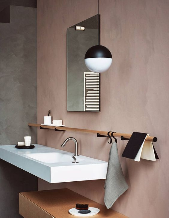 bathroom vanity with grey wall, rose pink wall, square mirror, wooden rail, pink rectangular sink vanity, wooden shelves under