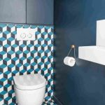 Bathroom With Blue Walls, Geometric Tiles On The Floor And Half Accent Wall, White Toilet