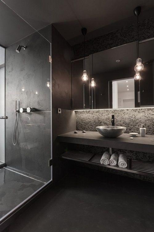 bathroom with dark grey floor, shower tiles, vanity, backsplash, sink, large mirror, pendant