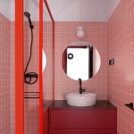 Bathroom With Pink Wall Tiles, Red Framed Glass Partition, Black Shower Faucet, White Sink, Red Cabinet, White Wall