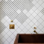 Bathroom With Square Tiels On The Wall In Different Sized, Copper Sink With Golden Faicet