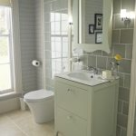 Bathroom With Tiles, Grey Wall Tiles, White Toilet, Sage Green Cabinet And Mirror, White Sink
