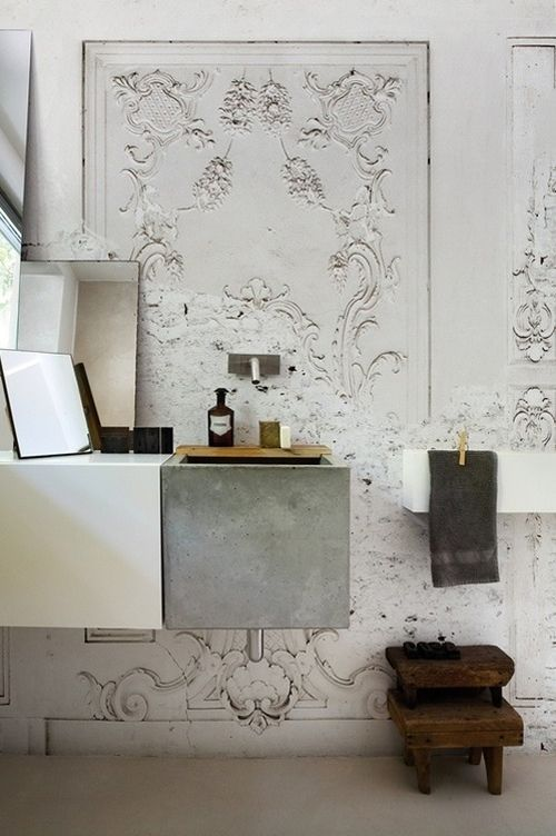 bathroom with white floor, white sink, grey concrete sink with wooden board, white vanity box with mirror