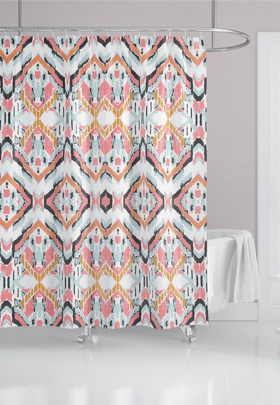 bathroom with white floor, white tub, white wall, ikat pattern curtain