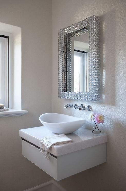 bathroom with white wall, white floating vanity with drawer, white sink, blink blink frame mirror