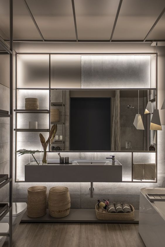 bathroom with wooden floor, concrete wall, concrete vanity with white sink and mirror in a big metal shelves with lighting behind