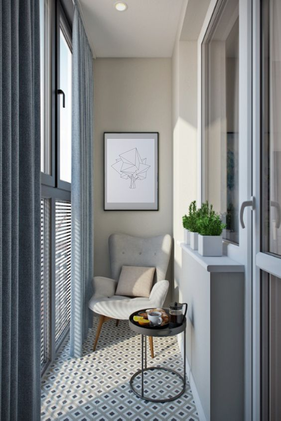 beautiful balcony with beige wall, grey wall, grey framed windows, patterned tiles floor, coffee table