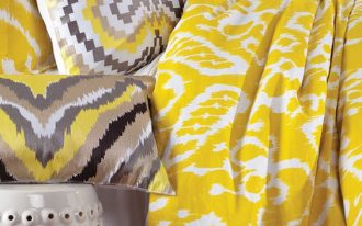bed with yellow ikat pattern in bedcover and pillow