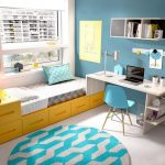 Bedroom With Beige Flooring, Blue Rug, Wooden Table, Yellows Platform Bed With Drawers And Headboard Drawers, Shelves