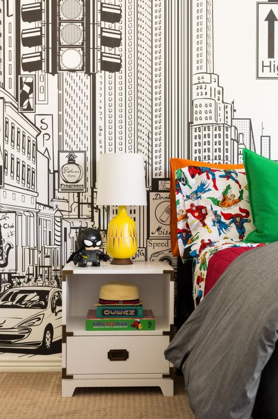 bedroom with city drawing wallpaper, white nightstand, batman lego figure, marvel dc linen