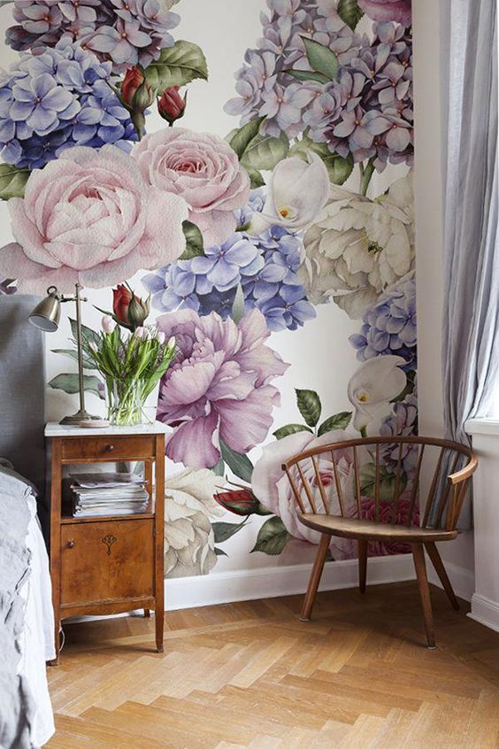 bedroom with herringbone patterns on the floor, white wall, flower accent wall with pruple flower in white background