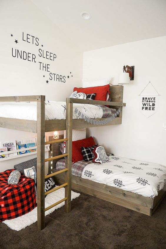 bedroom with rug, white wall, bunk bed with 90 degree different angle, whie rug, bean bag