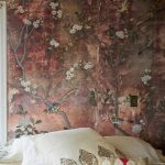 Bedroom With White Bohemian Bedding, Tree And Flower Wallpaper In Old Look