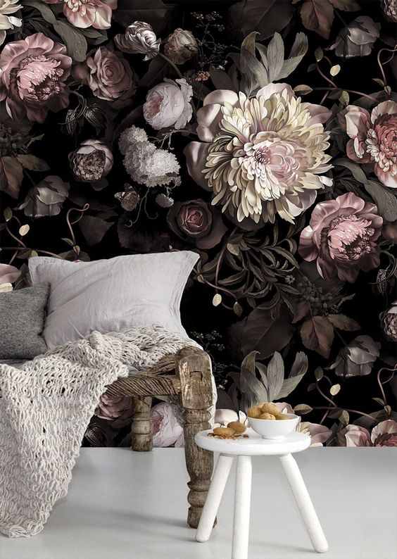 bedroom with white floor, whtie round stool, wooden wide bench, flower wallpaper on black background