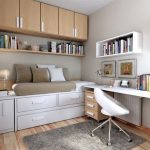 Bedroom With Wooden Floor, Brown Wooden Cupboards On Top With Bookshelves, White Drawers Under The Bed, White Table And Chair, White Shelves, Rug