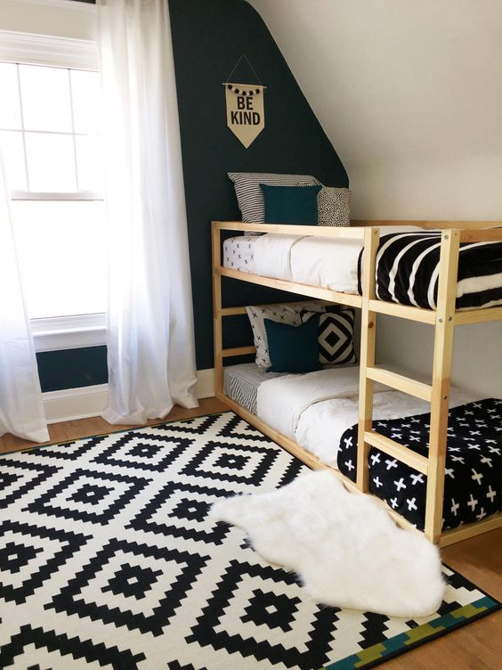 bedroom with wooden floor, rug, wooden simple bunk bed, green wall, white wall windows, curtains