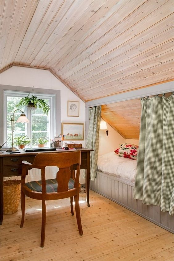 bedroom, wooden floor, brown wood planks, white wall, grey wooden bed platform, green bed curtain, windows, table and chair