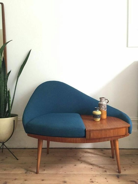 blue chair with wooden table built in the chair