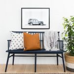 Blue Wooden Bench With Pillows In An Entryways With Wooden Floor, Rug, Rattan Pot With Plants, Picture