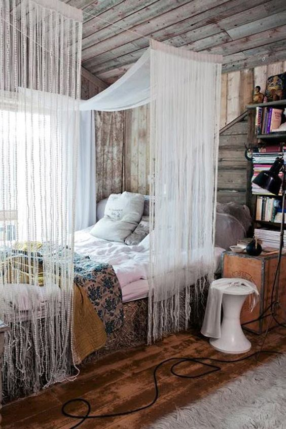 bohemian bed with colorful linen, white canopy on rop