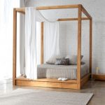 Brown Bed On Wooden Platform With Canopy Posts