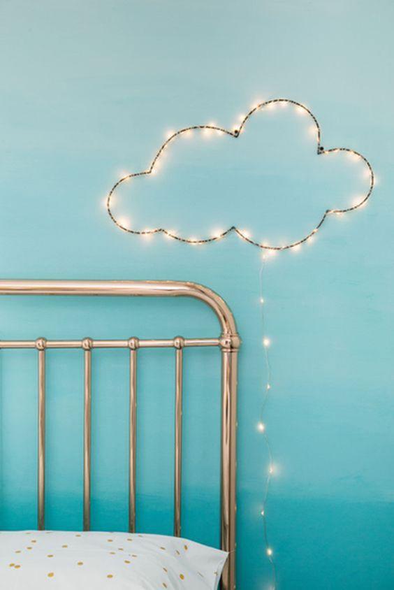 cloud shaped fairy lights on sky blue wall